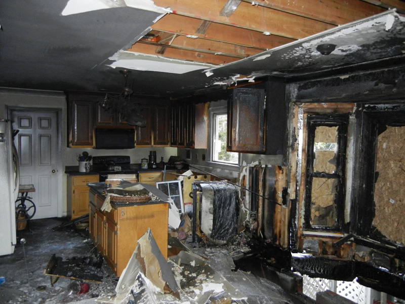 Picture of kitchen totally gutted be electrical fire.